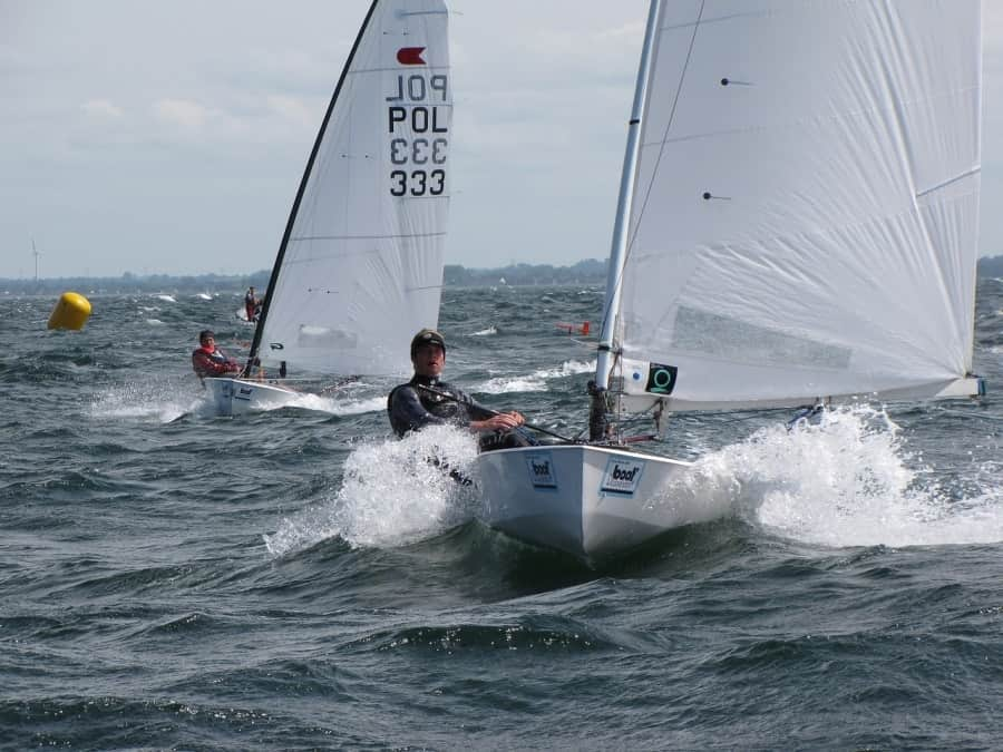 Racing sailing dinghies on water