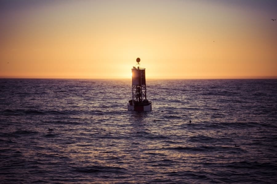 Buoy on the water at sunset