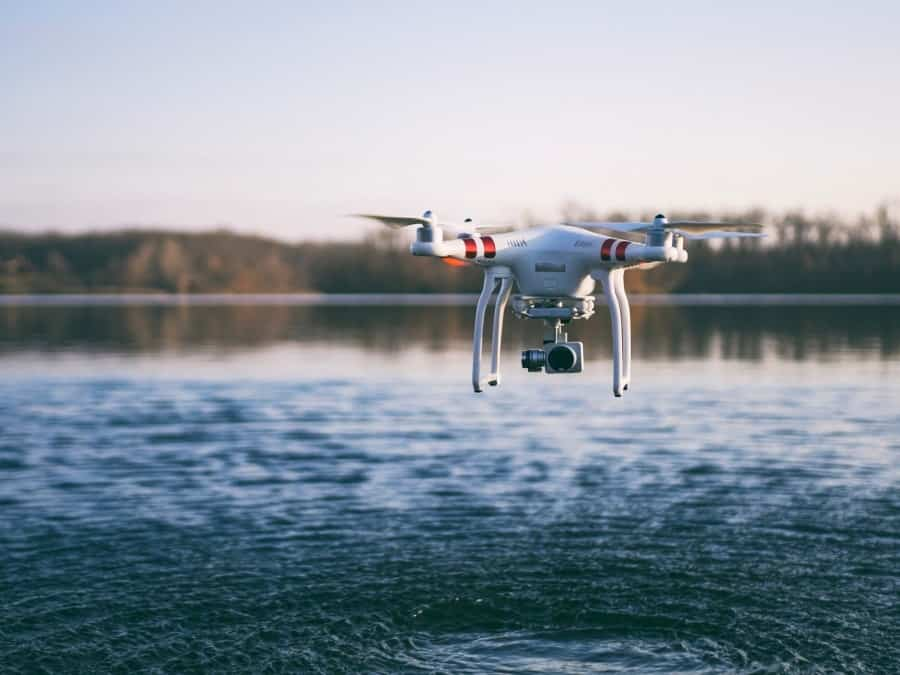 Drone hovering over water