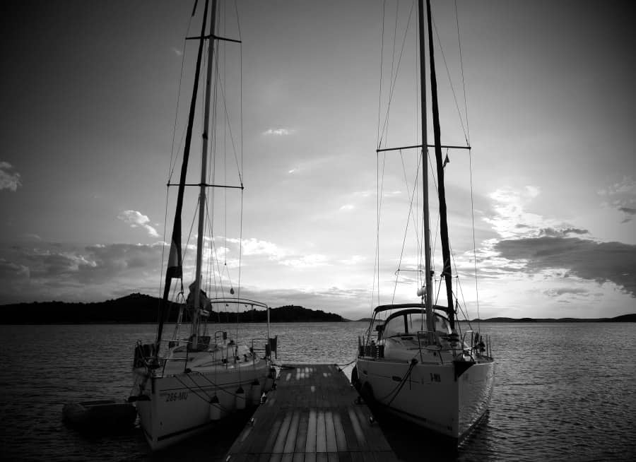 Two sailboats docked