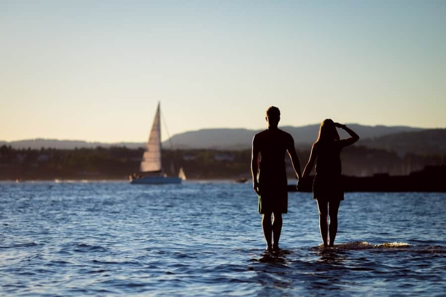 Couples looking at a sailboat