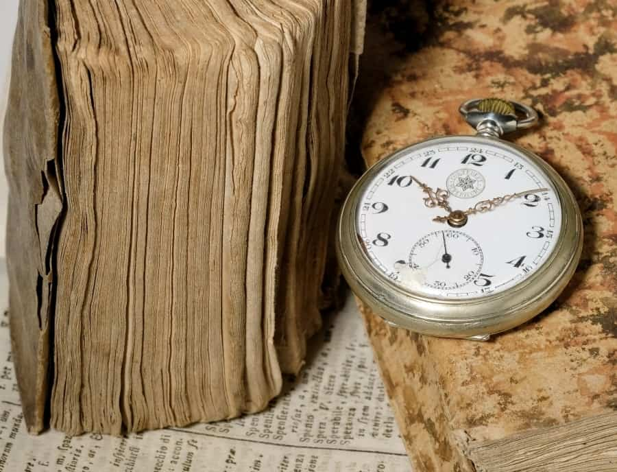 Pocket watch on old books