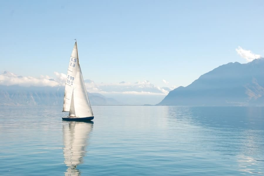 Single sailboat on calm water